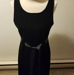 Black sleeveless velvet dress by J.B.S.